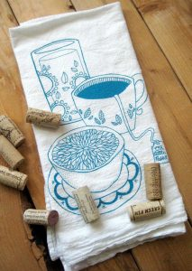A tea towel with tea cups printed on it