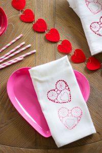 custom napkin with hearts folded over a plate
