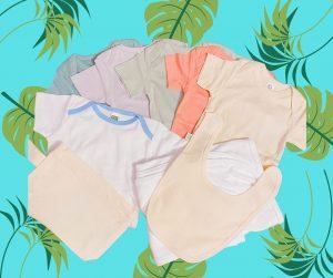 A variety of blank onesies, bibs and burp cloths